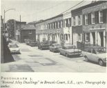 "Borchert's book includes a photograph he took of ""restored Alley Dwellings"" in Brown's Court, S.E."