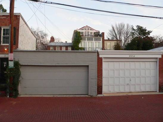 The owner of this property had hoped to build a guest room over his garage, but was opposed, so he built the rear addition with a new third floor, which was approved.