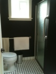 the bathroom features grab bars and other accessibility features