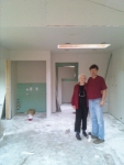 Shirley and builder Eric on drywalling day