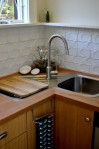 Dyer ADU kitchen with tiled backsplash