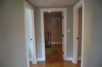 the hallway opens to the bathroom and bedrooms