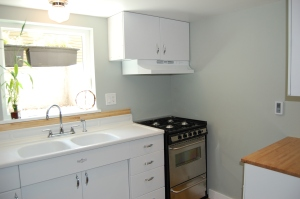 the kitchen is bright and airy