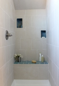 the Pozarycki ADU features reclaimed tile in the bathroom and kitchen
