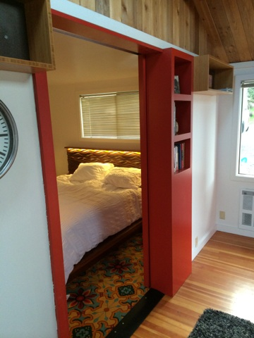 Caleb Bruce even included built-in storage in the sliding track door that closes off the bedroom!