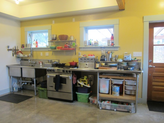 """We purchased used commercial kitchen counters, along with an old gorilla rack and a few new metal shelves from IKEA to create a pantry and save $6,000 on cabinets. The whole set-up cost a fraction of the quote we got on cabinets alone. The highlight of our ADU build was when the builders admitted that they initially were a bit wary about our unconventional kitchen layout (with no built-in cabinets), but eventually admitted that they were able to see that it would all work well and look good in the space."" -Lara Jones"