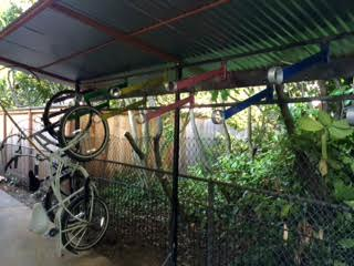 This custom bike rack, designed and build by Gustav Artist (who did most of the work on Lisa's ADU) allows the housemates plenty of bike parking.